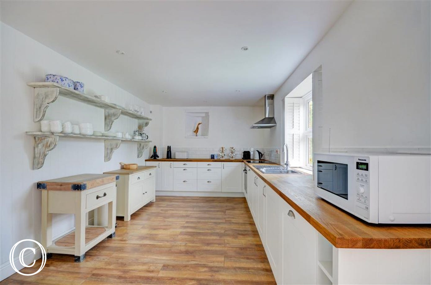 The kitchen is a spacious area with electric hob and oven