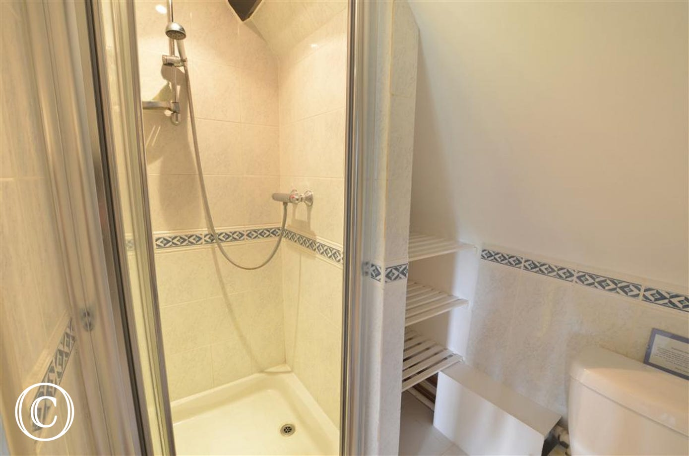 View of en-suite bathroom with shower cubicle.