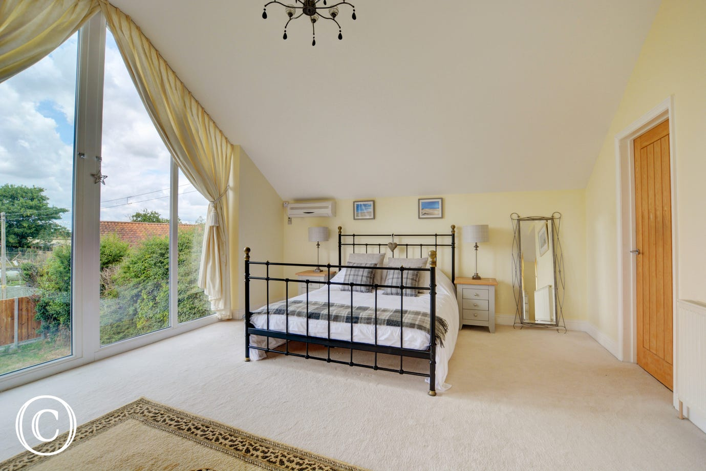 King size bedroom with lovely views