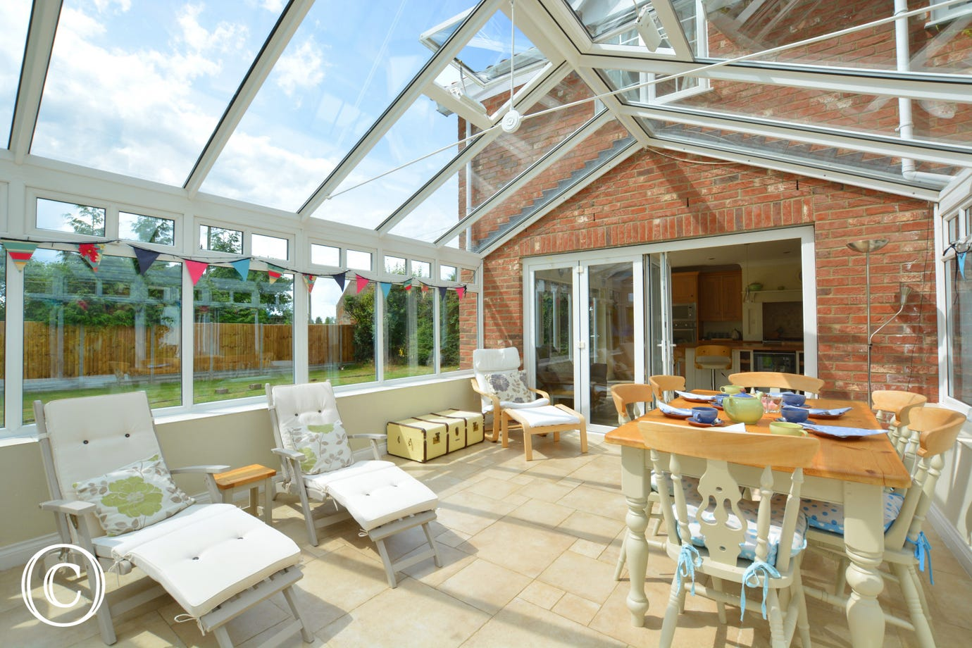 Conservatory with reclining loungers, table and chairs perfect for relaxing!