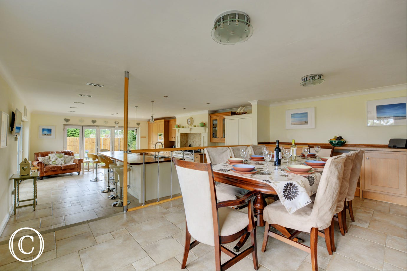 Light and airy open plan kitchen and dining area with table  and chairs