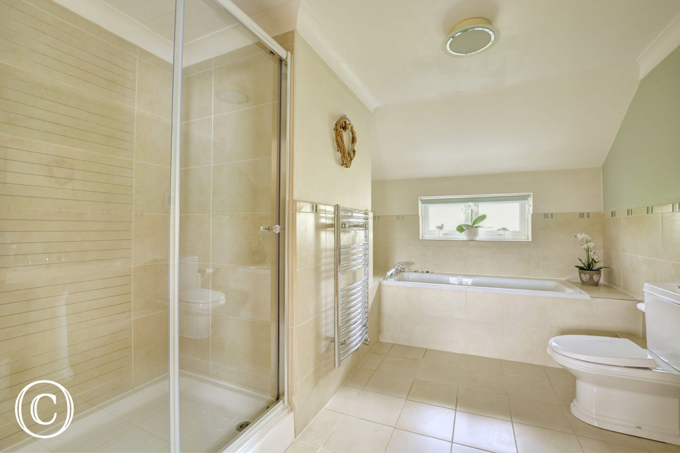 Family bathroom with shower cubicle, bath with hand held shower attachment, washbasin and w.c