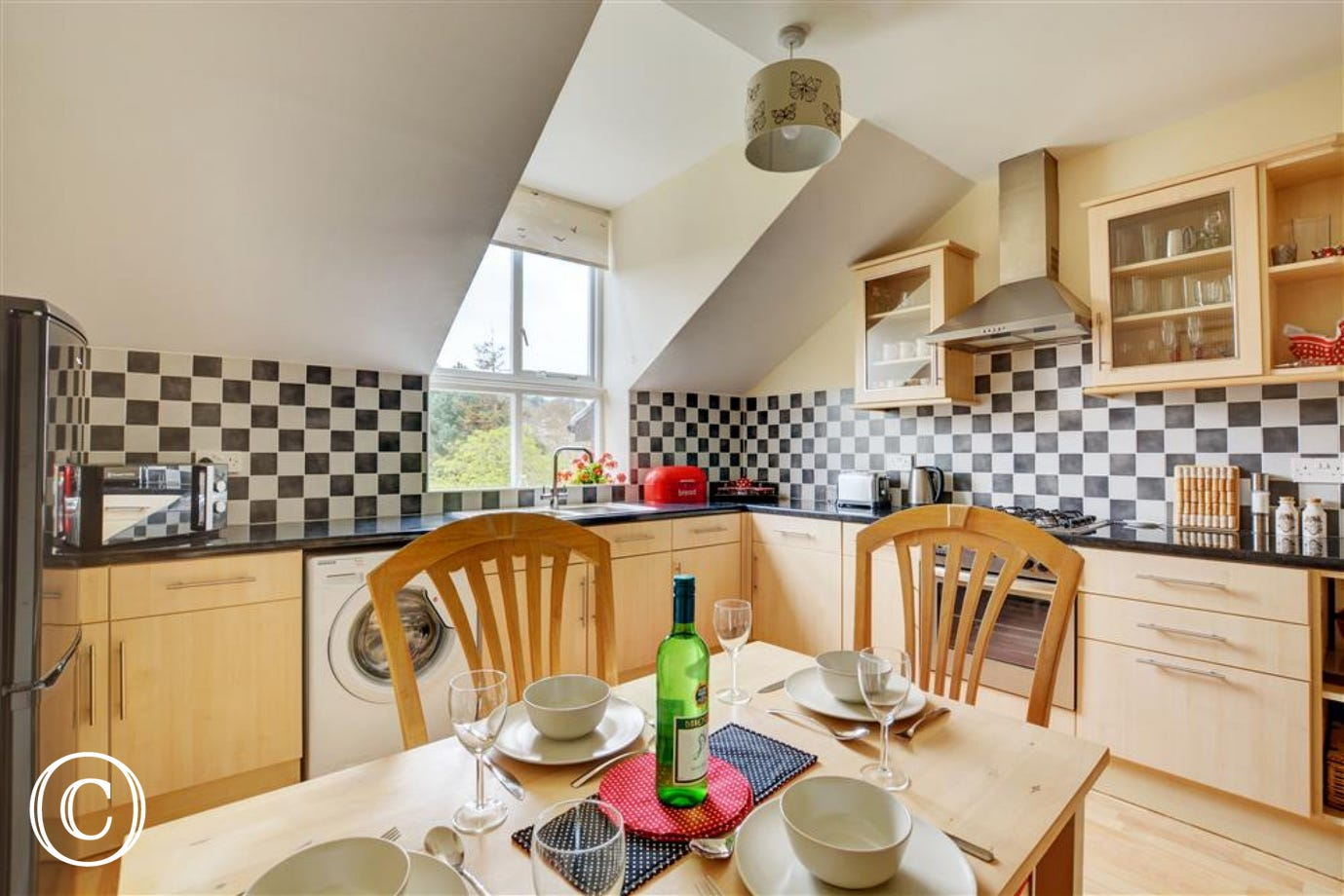 Kitchen and Dining Area electric built-in oven, gas hob, fridge/freezer, microwave, washer dryer, dining table and chairs