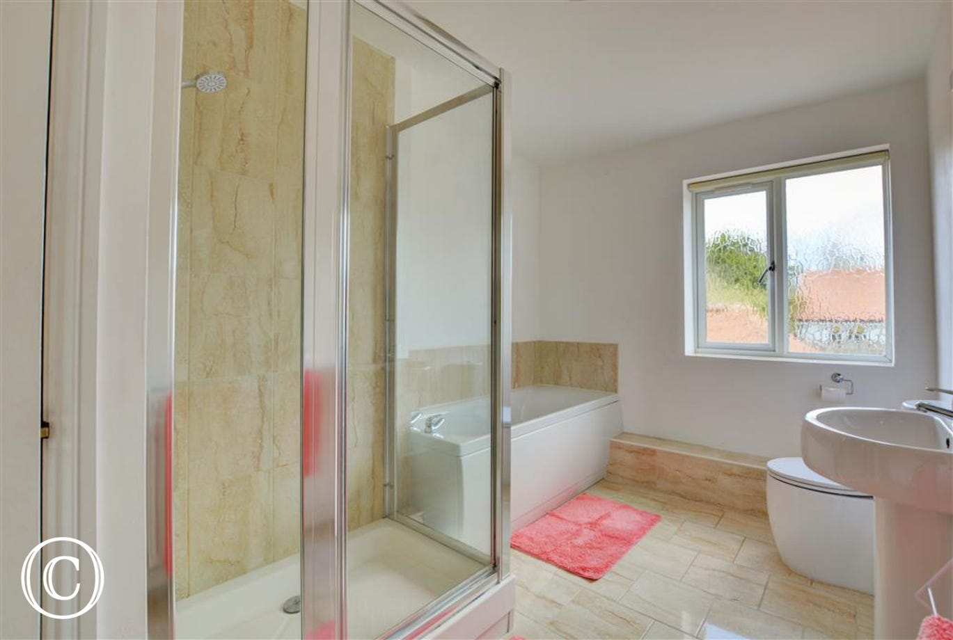 Bathroom with bath and shower cubicle