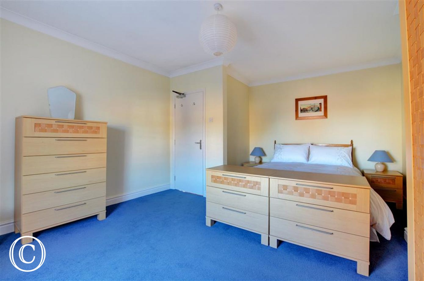 Large bedroom with ample storage