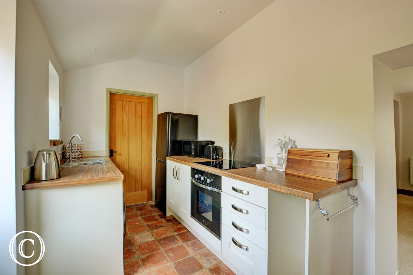 Attractive kitchen with built in oven and hob
