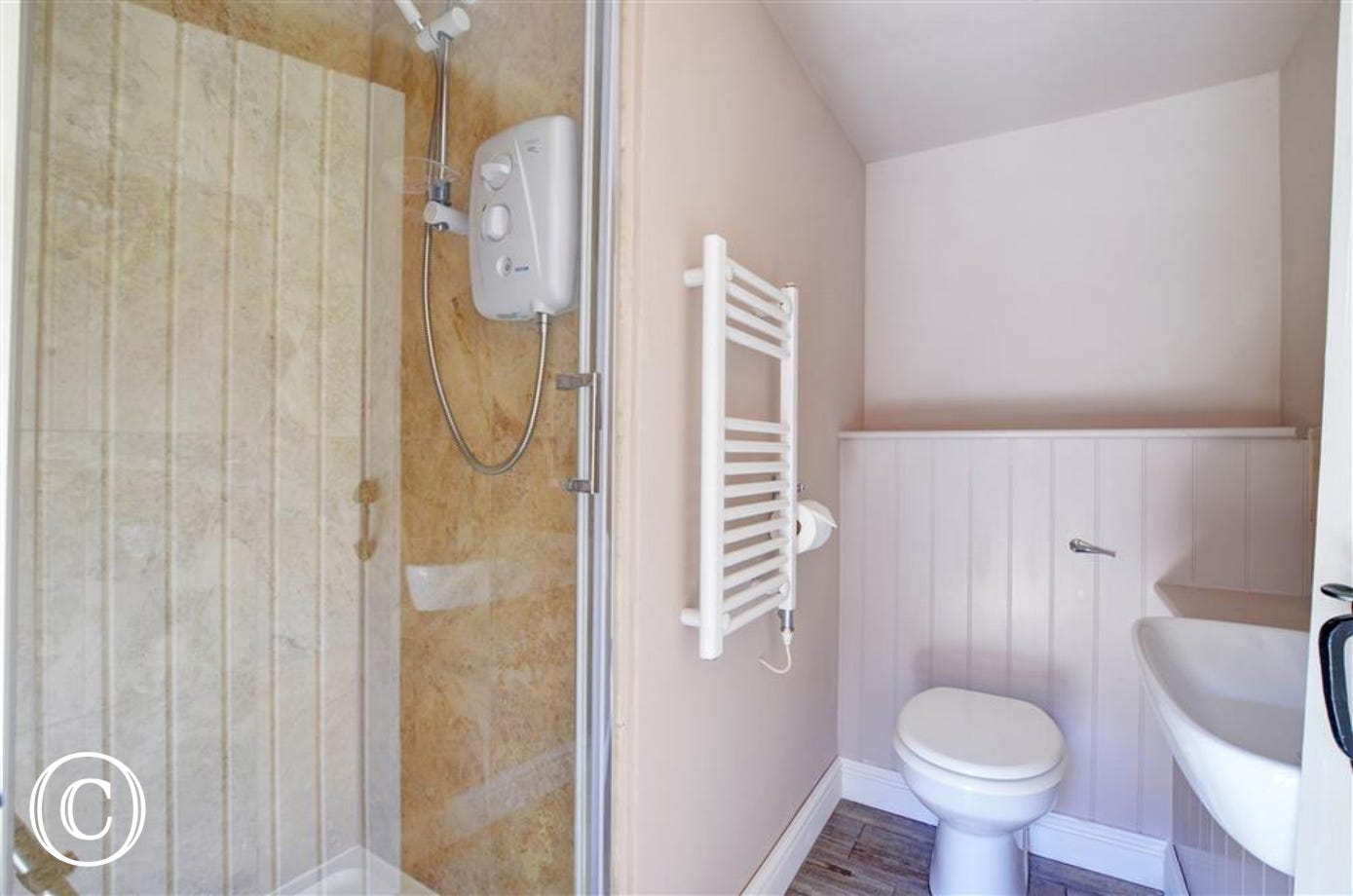 The shower room has a shower cubicle, WC and basin