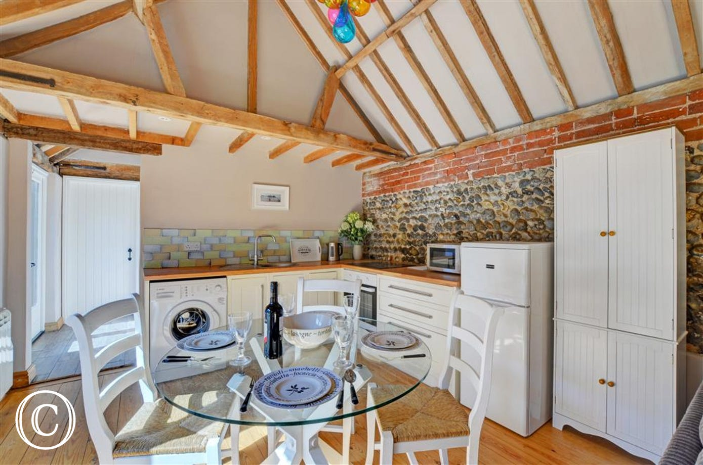 The kitchen is a lovely rustic room with electric oven and hob