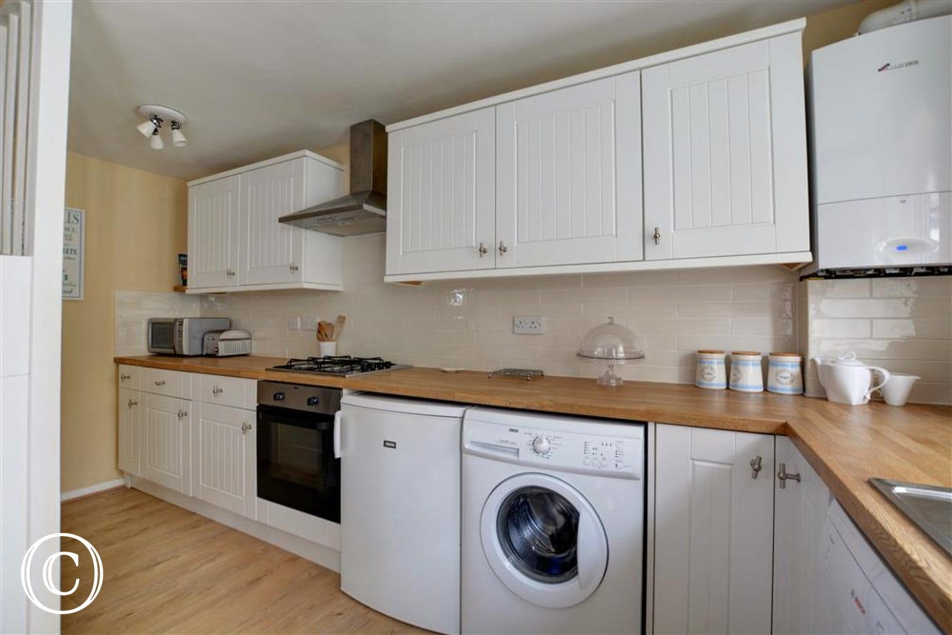 Kitchen with electric oven and gas hob