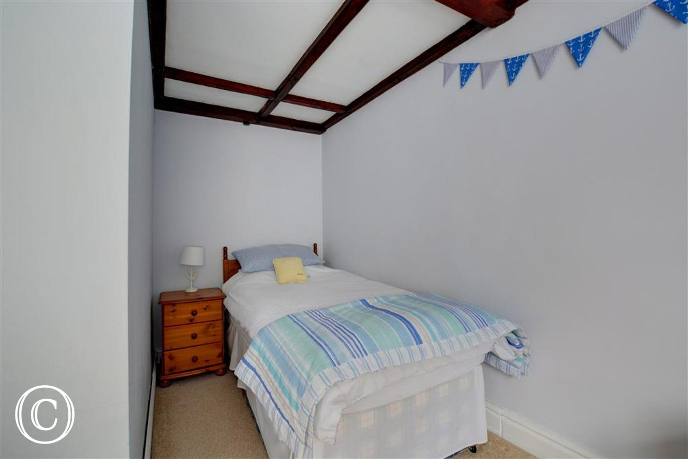 One of the single beds within bedroom three