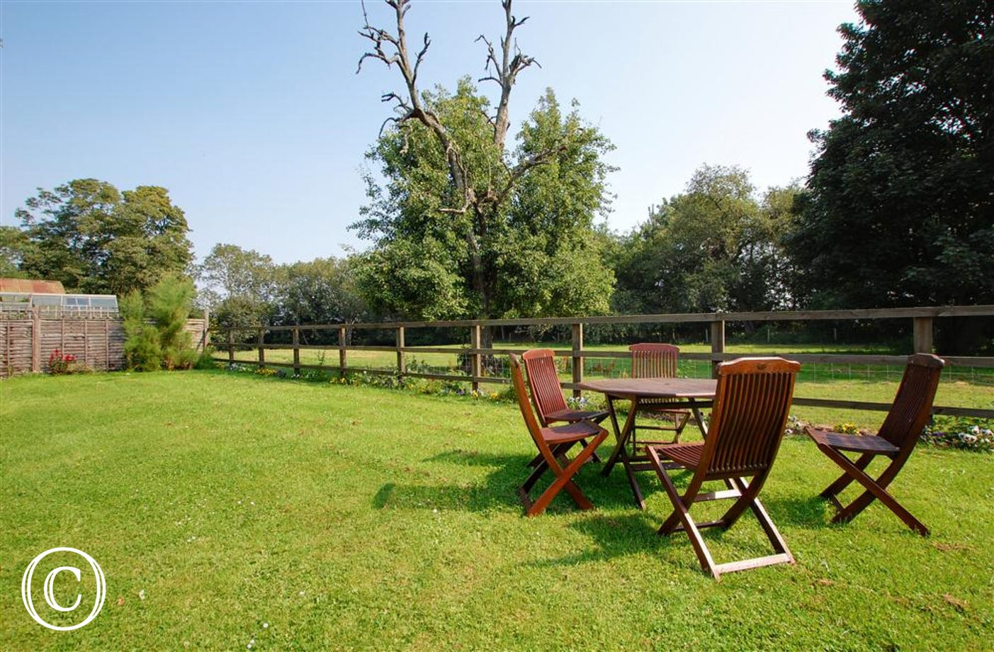 Shared open-plan lawned area with garden furniture and barbecue, perfect for al fresco dining