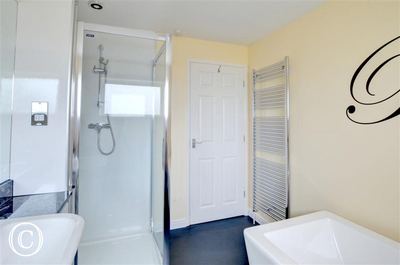 Alternative view of the bathroom showing shower cubicle.