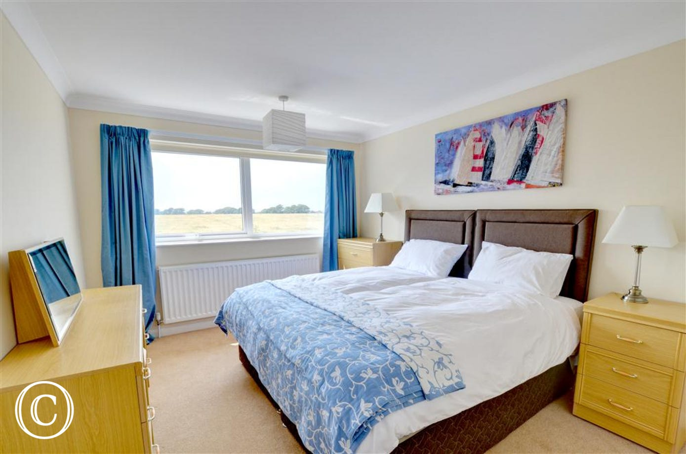 Spacious twin bedroom, beautifully presented with superb countryside rural views.