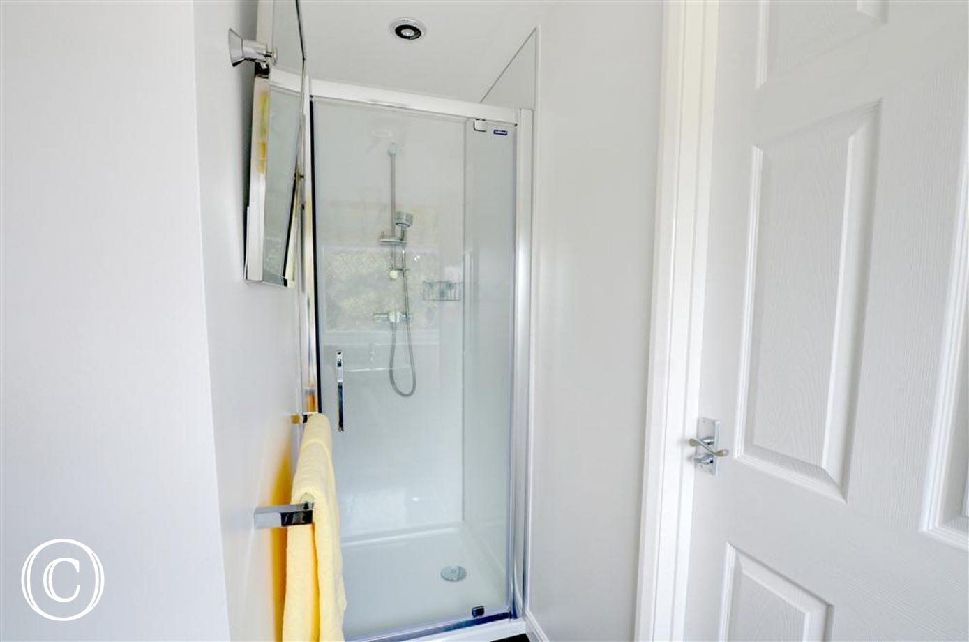 The En-suite showing shower cubicle and towels.