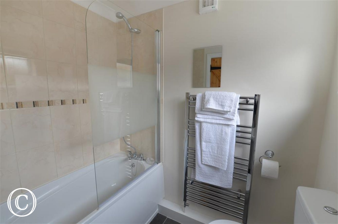 The newly fitted bathroom has a good sized heated towel rail.