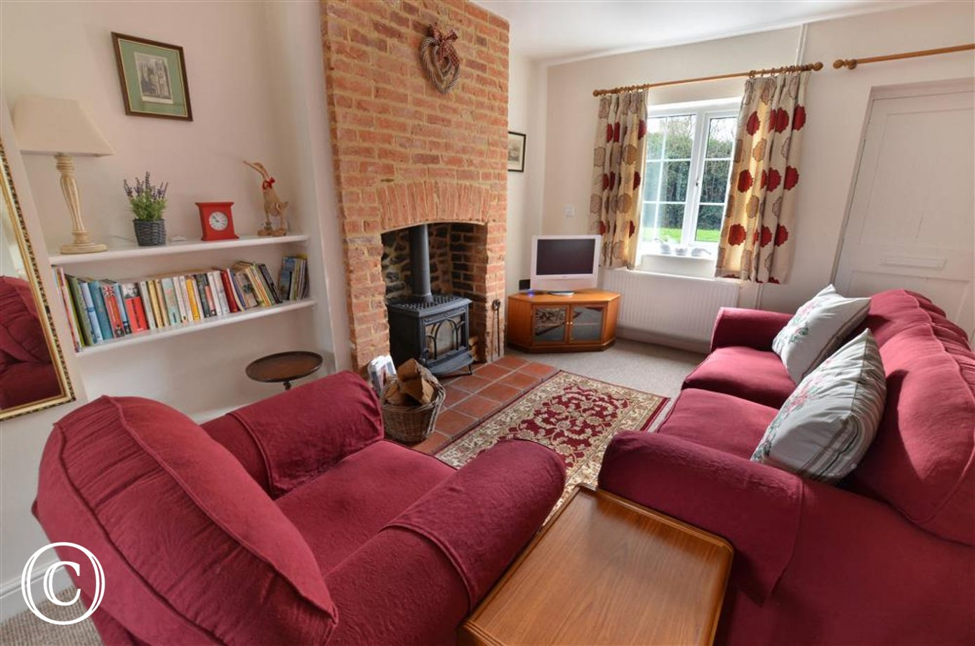 A cosy seating area around the log burner will ensure you have the perfect place for reading or watching the tv.