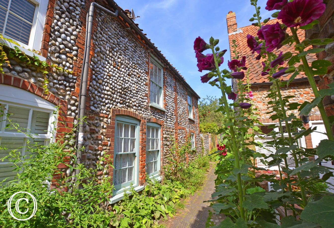 Hollyhock Cottage, built by traditional Norfolk brick and flint