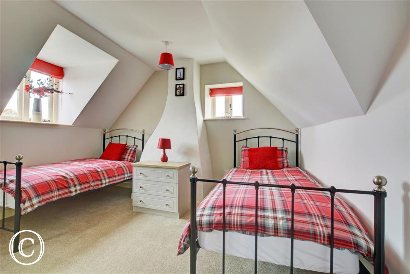 Twin beds within bedroom three