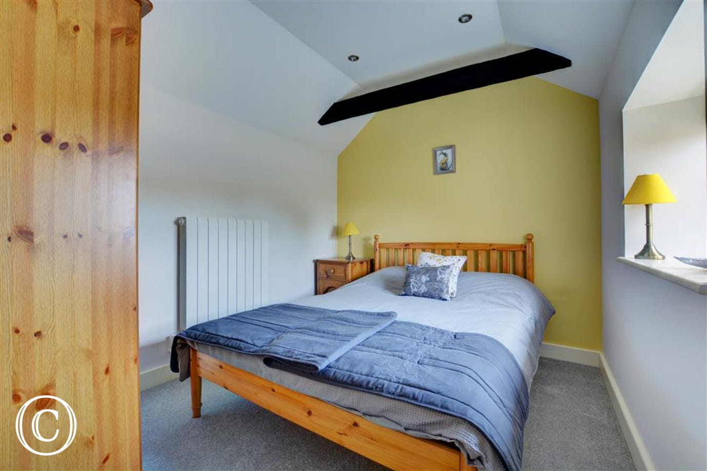 Bedroom four is a ground floor room wiith a double bed and en-suite shower room