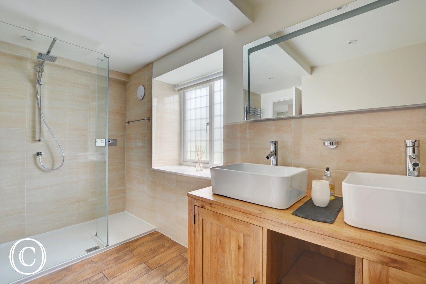Bedroom 1 En Suite with twin washbasin, shower cubicle and wc
