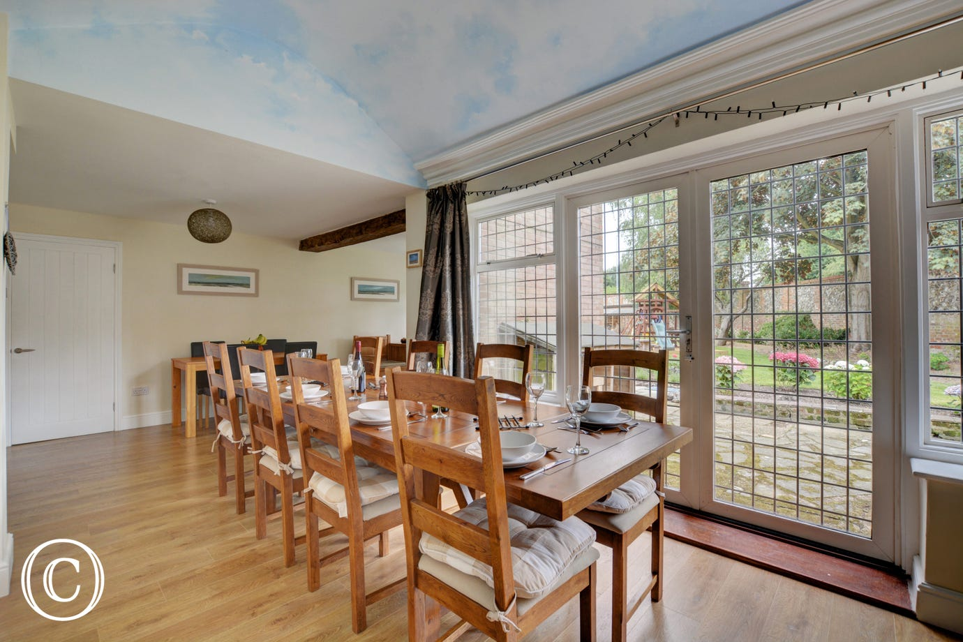Dining table and chairs, window with views of garden
