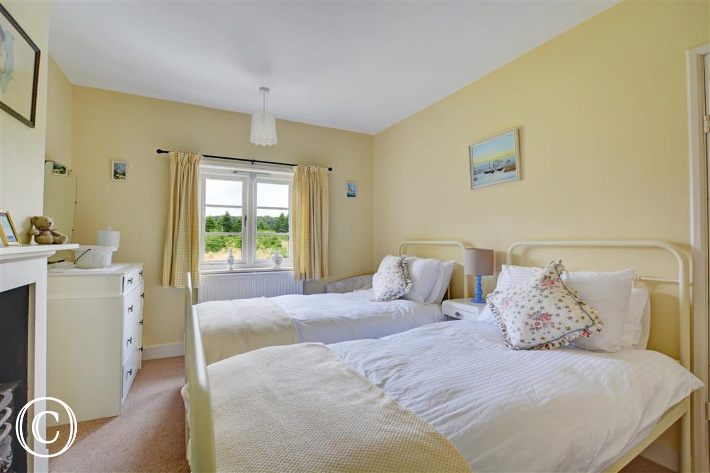 Bedroom three is a light and airy room with twin beds