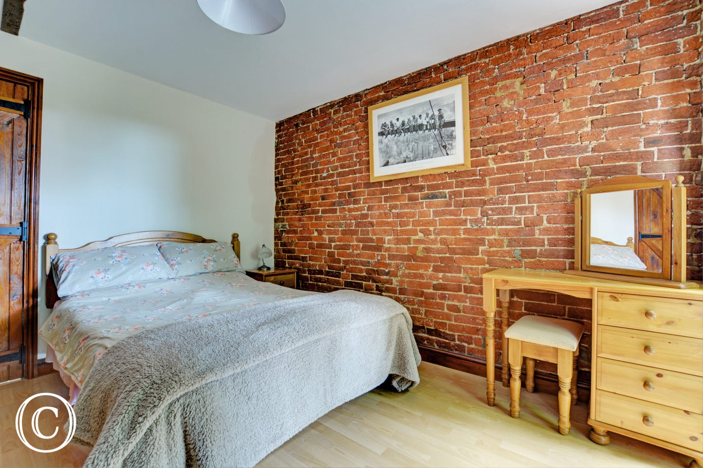 Characterful double bedroom with a double bed and exposed brickwork