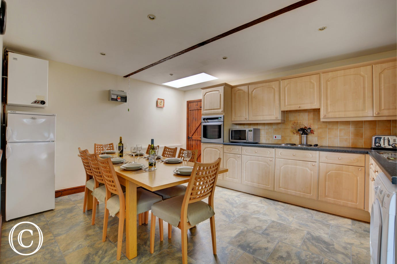 Spacious modern kitchen with most major appliances and a table and chairs to seat 8, ideal for family meals