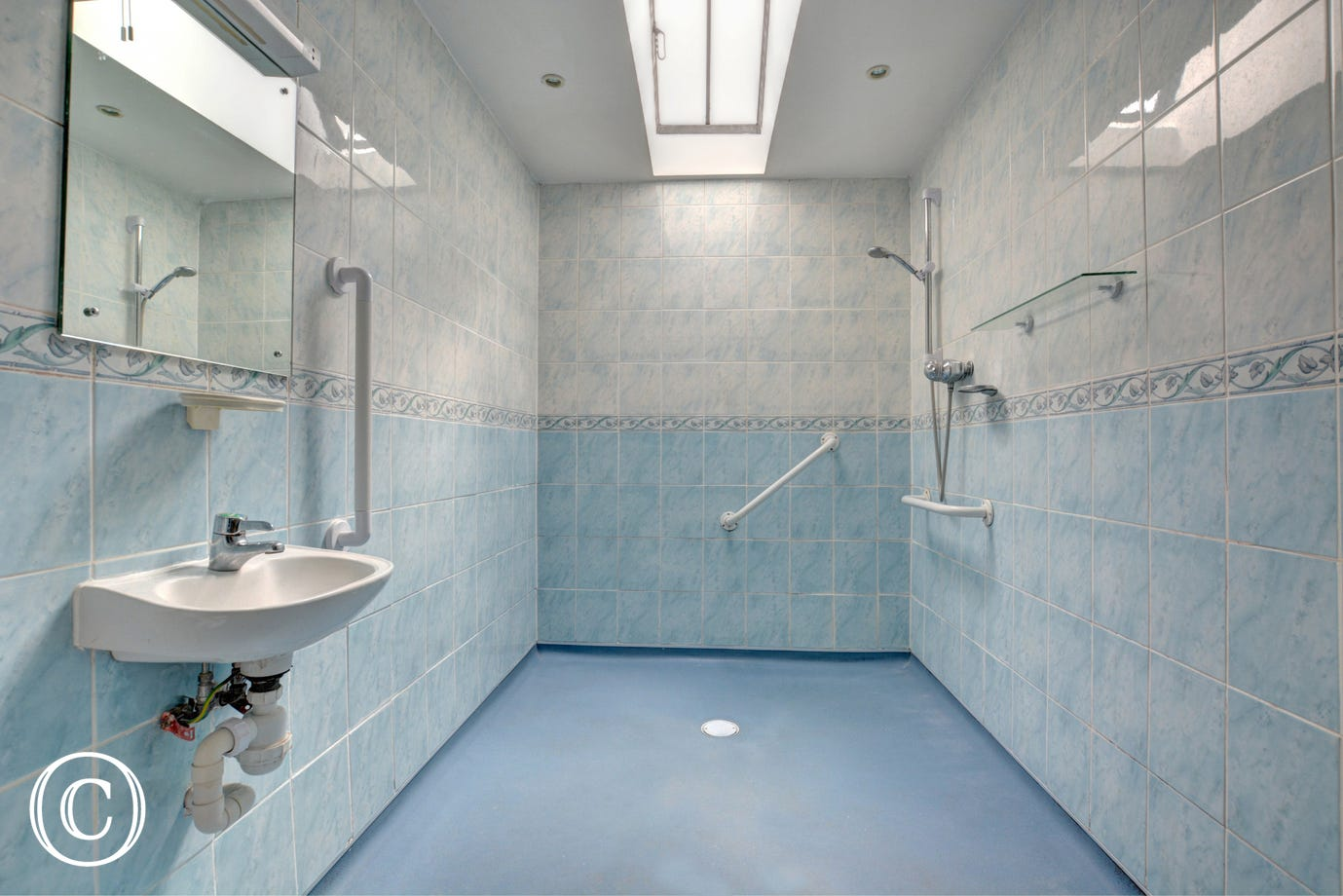 Modern shower/wet room with wheel-in shower, washbasin and wc - equipped for the less able
