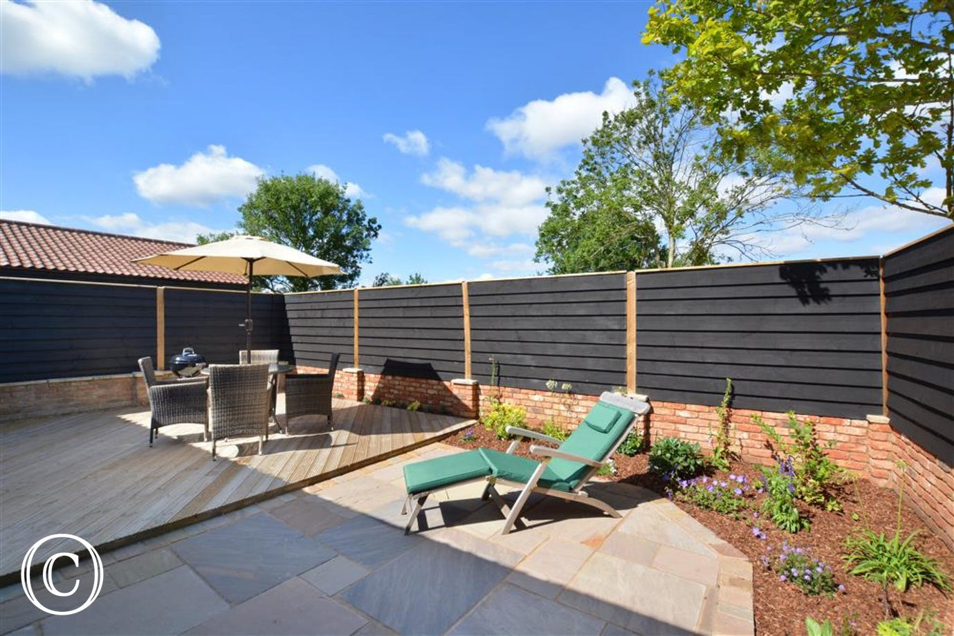 Lovely sunny garden with decking and seating