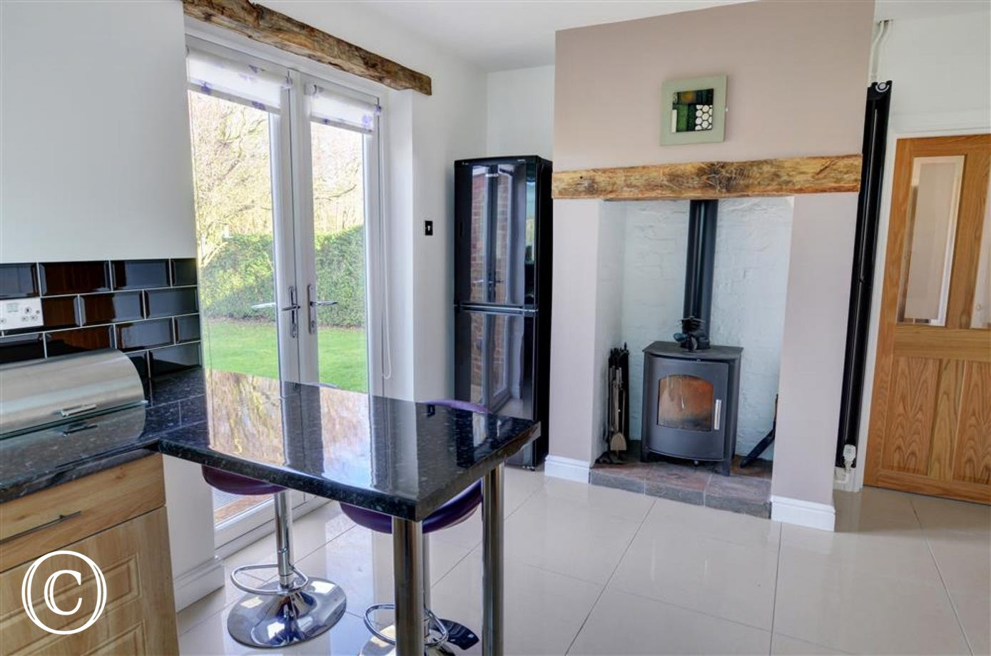 Another woodburner within the spacious kitchen
