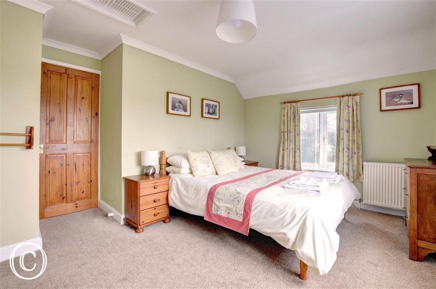 Double bedroom, with bedside table and chest drawers in pine.