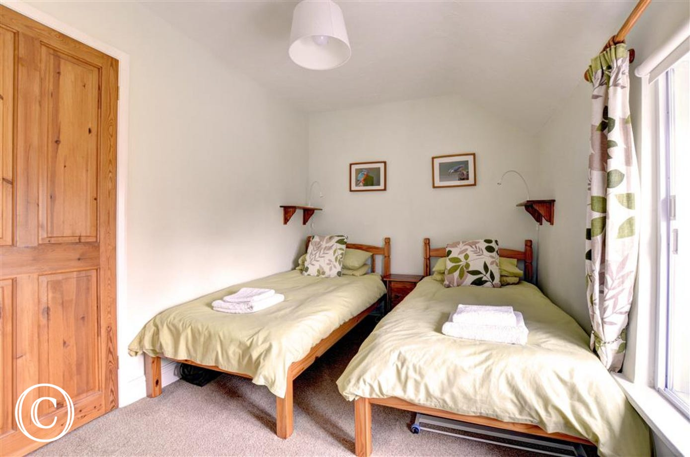 Twin bedded room, beds side by side, and window