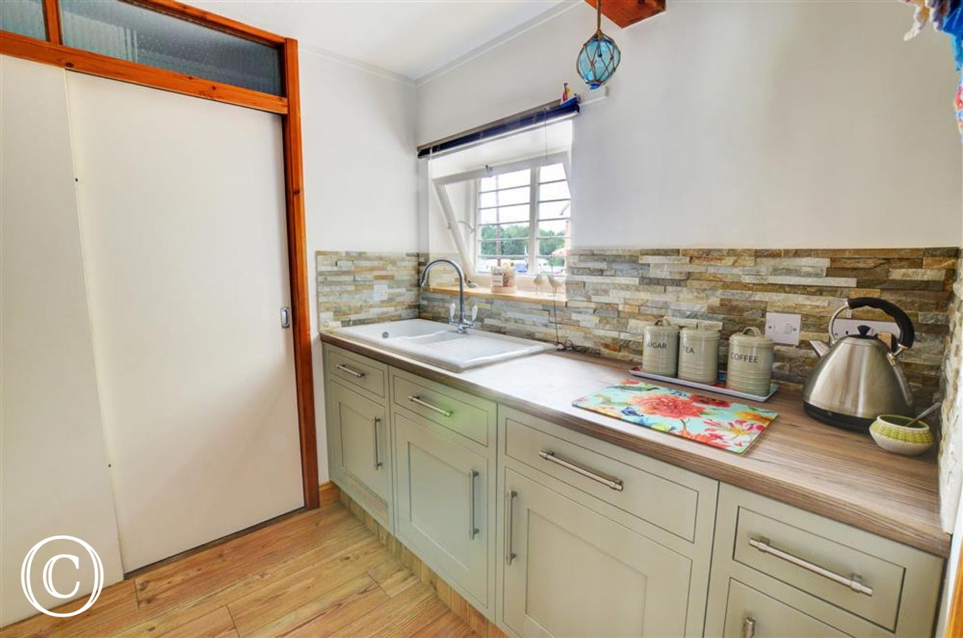 Another view of this attractively decorated kitchen