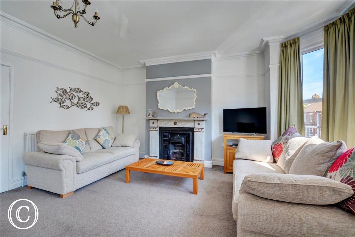 Lovely comfortable sitting room to relax in after a day at the beach