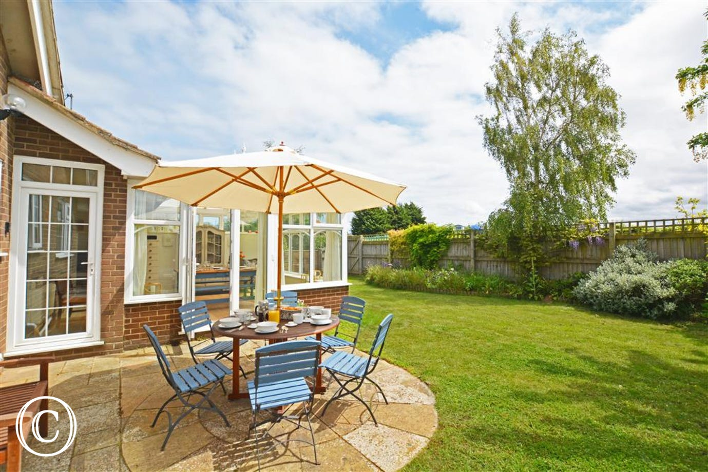 Lovely lawned garden with patio area