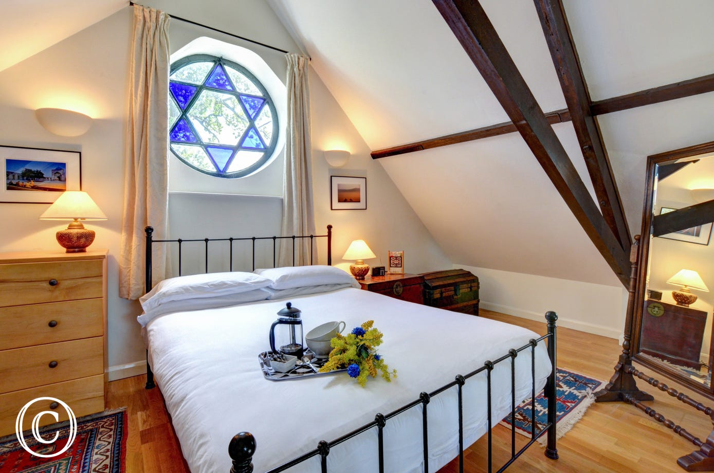 Double Bedroom with ornate window