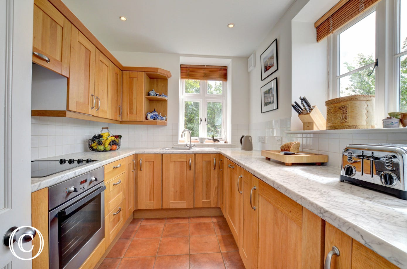 Kitchen equipped with built in electric oven, ceramic hob, microwave, fridge, freezer, dishwasher