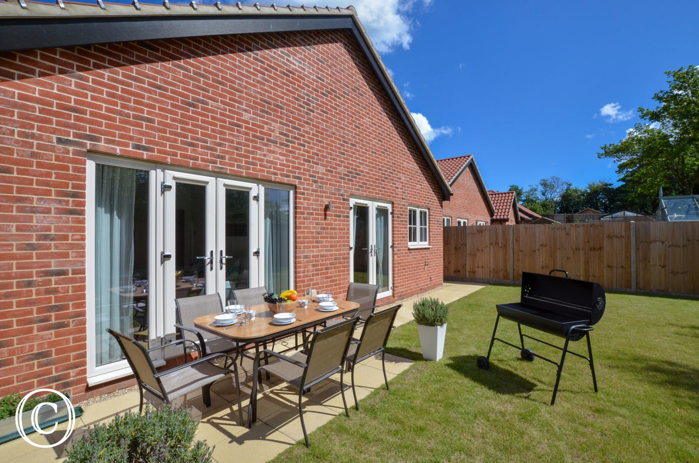 Rear garden with patio table and chairs