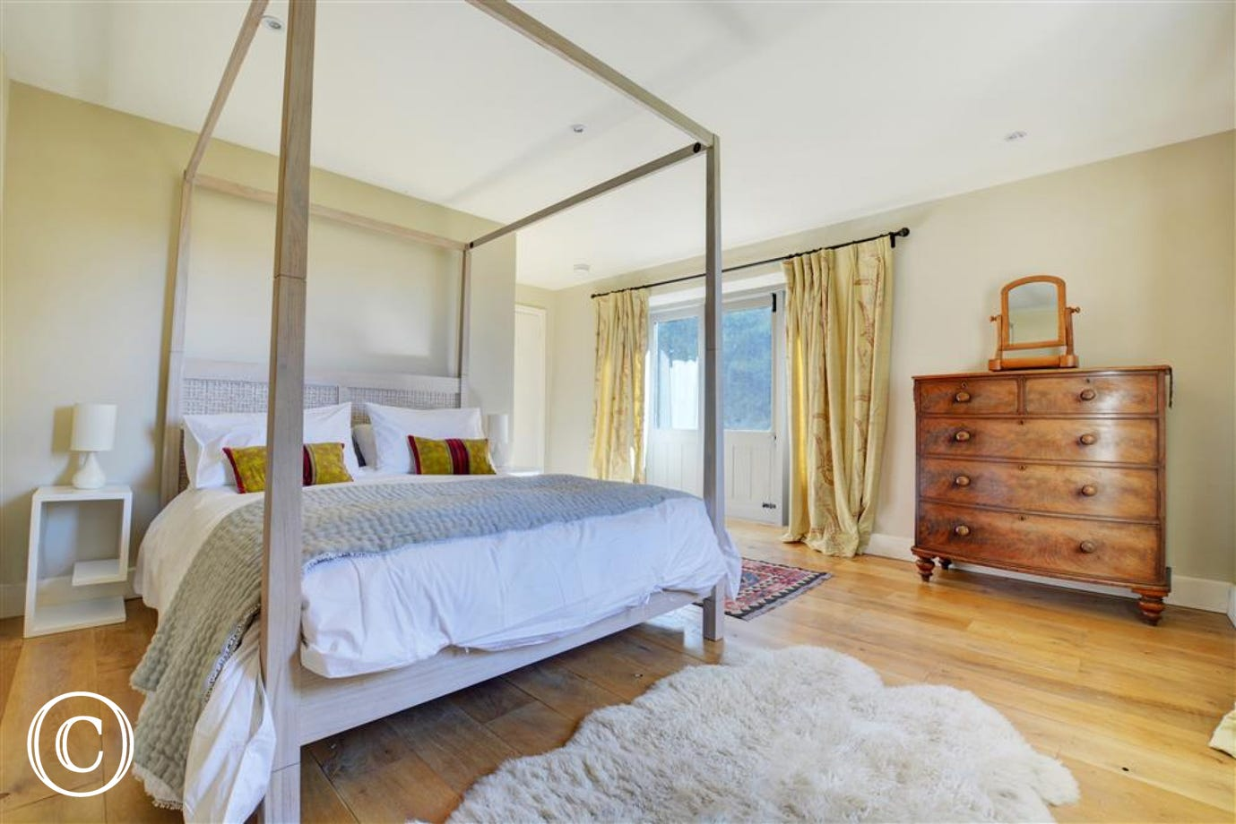 Main bedroom with king sized four poster bed