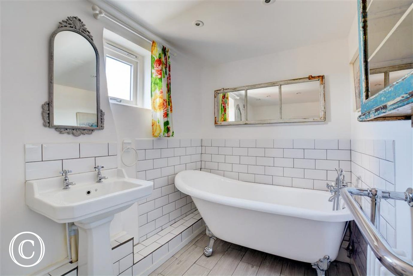 Beautiful bathroom with roll top bath