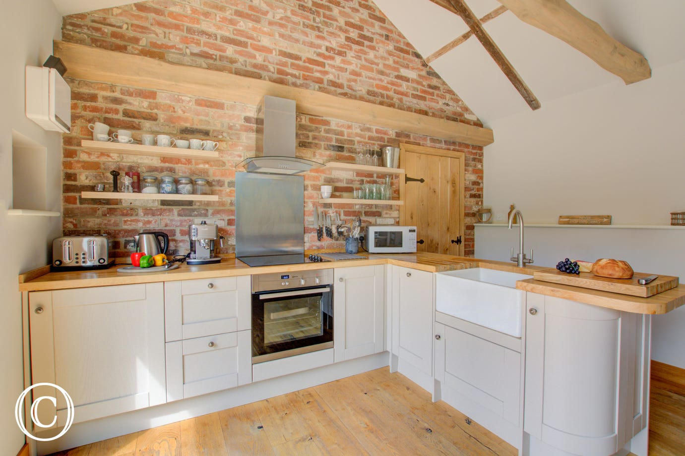 Kitchen with beautiful wooden beams,  electric built-in oven, electric induction hob, fridge, freezer, microwave, dishwasher, washing machine