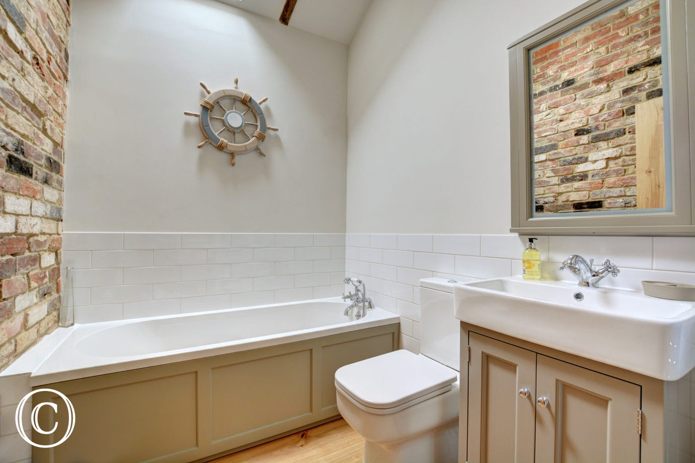 Stylish bathroom with bath, washbasin and wc