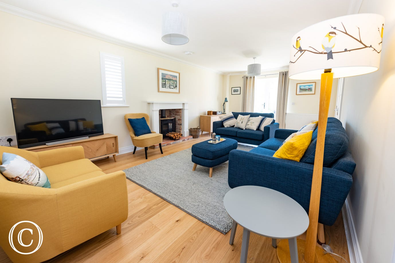 Sitting Room with comfortable seating, TV & wood burner