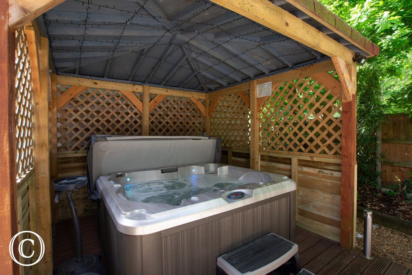 Sheltered decking area with hot tub!