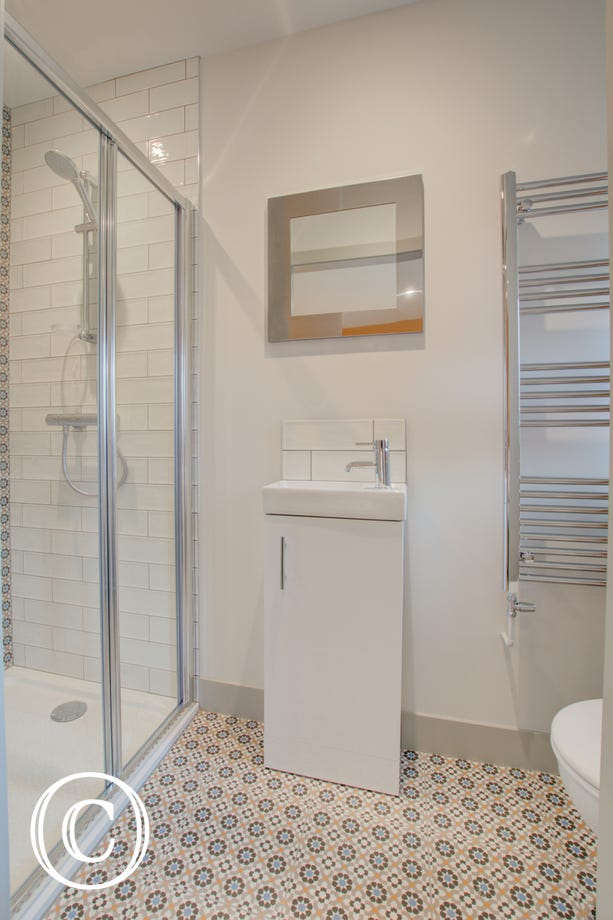 Bedroom 2 En-suite with shower cubicle & wash basin