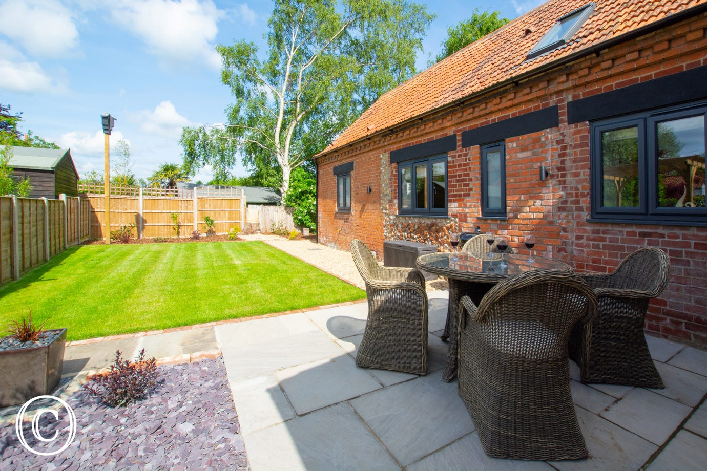 Lawn & patio area with garden furniture