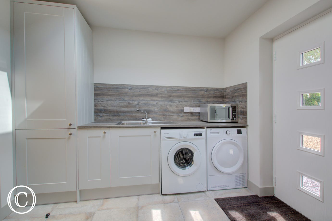 Utility room with fitted units, washing machine & tumble dryer