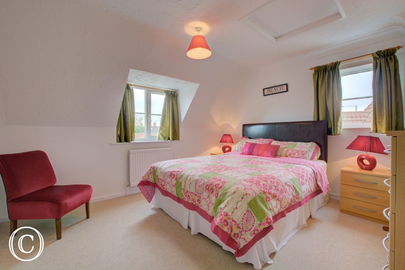 Bedroom two also offers a double bed and is attractively decorated.
