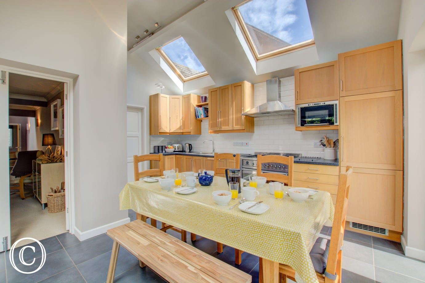 Kitchen with fitted units & dining table & chairs